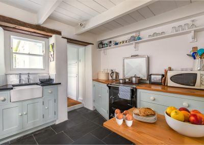 Kitchen with view of cooker, microwave and breakfast table