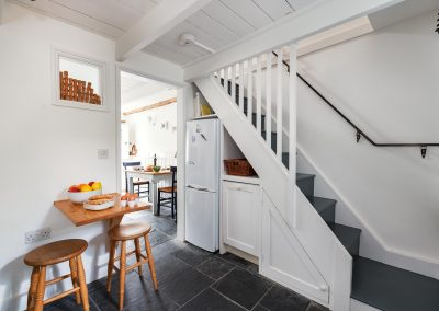 Kitchen with view of stairs and breakfast table
